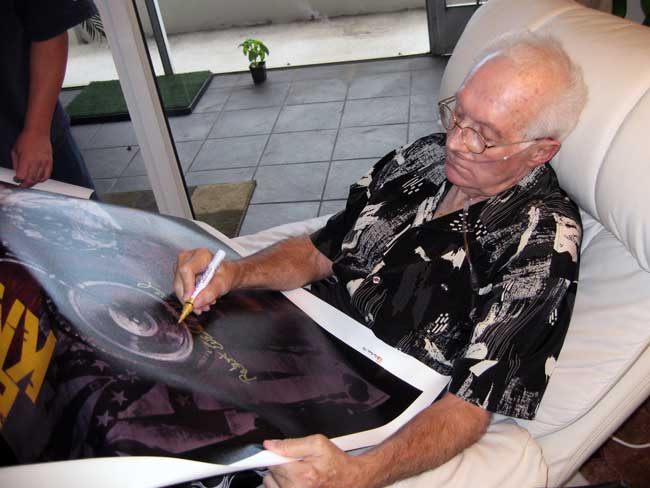 Evel Knievel signing his Stephen Holland prints