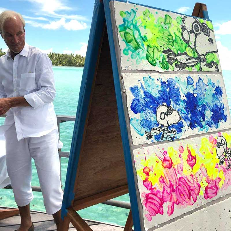 Tom Everhart paints partly Cloudy. Snoopy as the flying ace in the skys of Tahiti